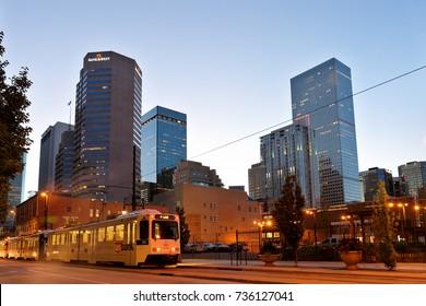 Denver Colorado, USA - September 4, 2016: Denver Downtown at Early Morning. Photo Shows Rail Train Running on California Street, Denver Colorado.