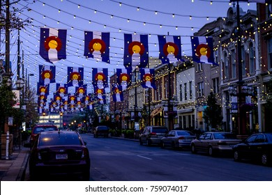 DENVER COLORADO / USA - September 4 2017: Special light and flag display of Colorado State Flags and bistro lights in historic Larimer Square in lower downtown Denver. September 4 2017 in Denver, CO