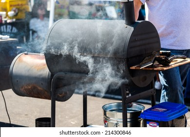 Denver, Colorado, USA-August 30, 2014. Large barbecue smoker cooking meat.