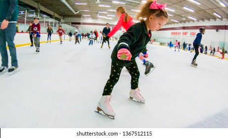 Denver, Colorado, USA-December 16, 2018 - Public ice skating at indoor ice skating rink.
