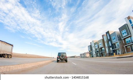 Denver, Colorado, USA-December 26, 2018 - Driving through new residential neighborhood in suburbia.