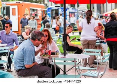 Denver, Colorado, USA-June 11, 2015.  Gathering of gourmet food trucks and carts in Downtown Denver Civic Center Park.