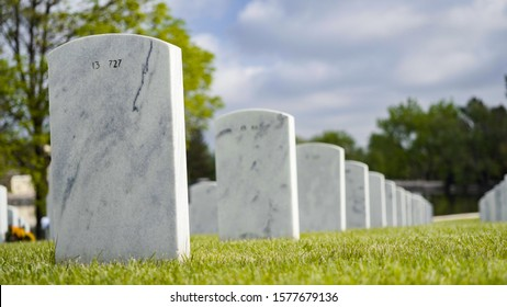 Denver, Colorado, USA-May 26, 2019 - An endless rows of white marble gravestones at the