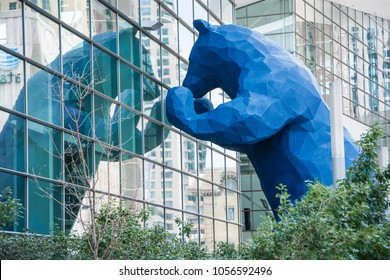 "DENVER, COLORADO/U.S.A. - JULY 2, 2016: The  40-foot-high Blue Bear ""I see what you mean"" sculpture imparts a sense of fun and playfulness as it peers into Denver's downtown convention center."