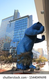 DENVER, COLORADO/USA - OCTOBER 22, 2019: The 40-foot-high sculpture of the Blue Bear at Colorado Convention Center in Denver. A big bear looking inside the glass building.