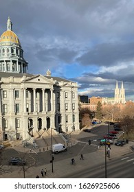 Denver, CO/USA- January 17, 2020: In capitol hill, these historic buildings sit in the lowering sun. The Denver State Capitol and Cathedral Basilica of Immaculate Conception.