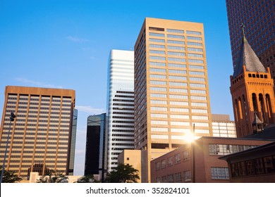 Denver in the morning with the rising sun reflecting in the building