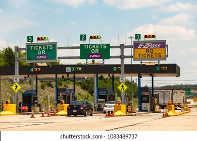 Denver, PA, USA – June 20, 2016: Vehicles approach the entrance toll plaza at the Pennsylvania Turnpike Interchange.