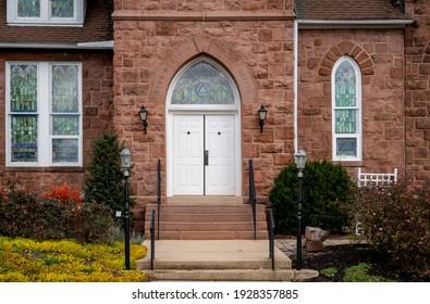 Denver, Pennsylvania - December 1, 2020: The Reamstown Memorial Lutheran Church under a cloudy winter sky in the small town of Denver, Pennsylvania.
