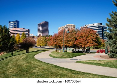 The Denver Tech Center skyline, or DTC, in Autumn with beautiful trees and walking path.