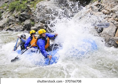 Denver, USA - July 11, 2010: A group of friends raft on Clear Creek near Denver, Colorado