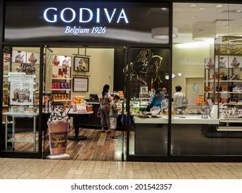 DENVER, USA - JUNE 25, 2014: Unidentified people at Godiva shop in Denver. Godiva Chocolatier is a manufacturer of premium chocolates founded in Belgium in 1926.