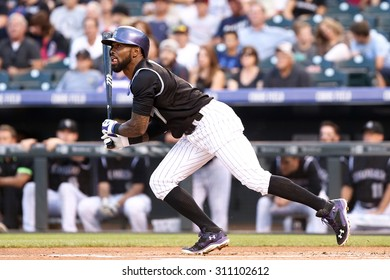 DENVER-AUG 21: Colorado Rockies infielder Jose Reyes swings at a pitch during a game against the New York Mets at Coors Field on August 21, 2015 in Denver, Colorado.