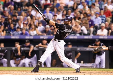 DENVER-AUG 21: Colorado Rockies outfielder Charlie Blackmon swings at a pitch during a game against the New York Mets at Coors Field on August 21, 2015 in Denver, Colorado.