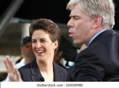 DENVER-AUG. 25:MSNBC TV pundits Rachel Maddow and David Gregory speak during a live broadcast from the 2008 Democratic National Convention on August 25, 2008.