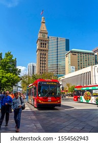 DENVER,COLORADO,AMERICA- SEPTEMBER 11,2019: Bus and big ben on the 16th street mall  in Denver, Colorado,United States.There are always a lot of tourists on September 11,2019.