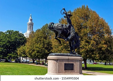 DENVER,COLORADO,AMERICA- SEPTEMBER 11,2019:Monument in the central park of Denver,Colorado -  the Broncho Buster. Artist: Frederic Remington 1861–1909.