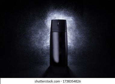 Deodorant in a black metal can on a black background with splashes at the back. Advertising photo of an aerosol antiperspirant. Mocap bottle with spray of water. 3d mockup.