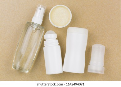 Deodorant Spray, roll-on, homemade cream, powder, mineral alum crystal stick. Underarm antiperspirant products with no aluminum salt on yellow tile background
