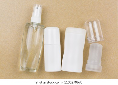 Deodorant Spray, roll-on, powder, mineral alum crystal stick. Underarm antiperspirant products with no aluminum salt on yellow tile background