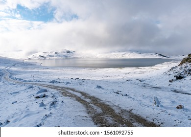 Deosai National Park Picturesque Breathtaking View Sheosar Lake with Snowy Landscape on a Sunrise Blue Sky Day