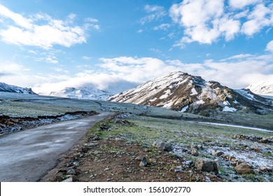 Deosai National Park Picturesque Breathtaking View of Snowy Landscape with Snow Capped Mountains on a Sunrise Blue Sky Day