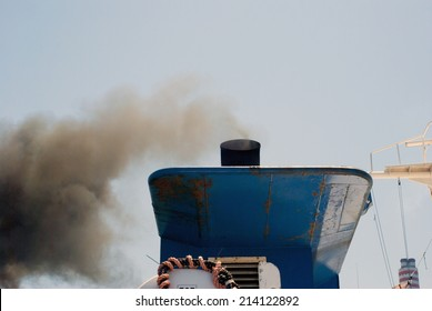 departing ship with smoke emission and air pollution