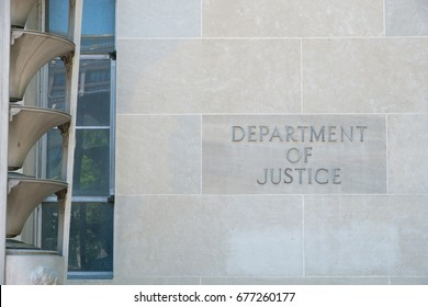 Department of Justice engraved on the exterior of the building