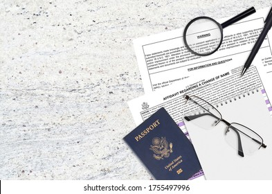 Department of State form DS60 Affidavit Regarding a change of name lies on table and ready to fill. Paperwork during operations with US Passport concept