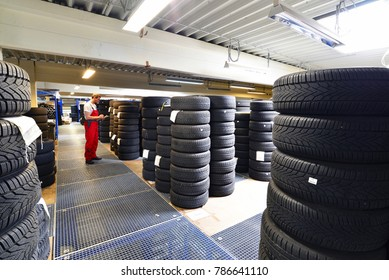 department store with car tyres in a garage - tyre change