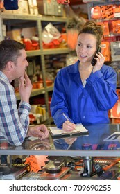 department store seller assisting customer buying
