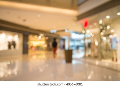 Department store shopping mall blur background with bokeh - Warm lighting decoration