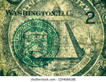 The Department of the Treasury Seal and the pyramid, highly magnified surface of used 1 dollar banknote with visible details of cotton fiber paper, with all flaws, watermarks and traces of usage.