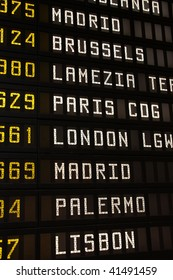 Departure board at an airport in Italy. Flights to Madrid, Brussels, Lamezia, Paris, London, Palermo and Lisbon.