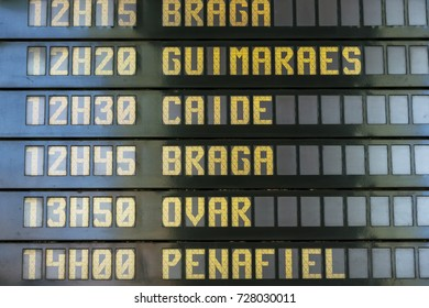 Departure board at the Sao Bento railway station in Porto, Portugal