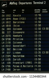 A departure board showing filghts information at Munich airport. travel information.