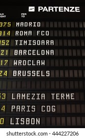 'Departure' in Italian. schedule at an airport in Italy. Flights to Madrid, Rome, Timisoara, Barcelona, Wroclaw, Brussels, Lamezia, Paris and Lisbon.