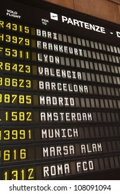Departure schedule at an airport in Italy. Flights to Bari, Frankfurt, Lyon, Valencia, Barcelona, Madrid, Amsterdam, Munich, Marsa Alam and Rome. No airlines symbols visible.