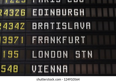 Departure schedule at an airport in Italy. Flights to Edinburgh, Bratislava, Frankfurt, London and Vienna. No airlines symbols visible.