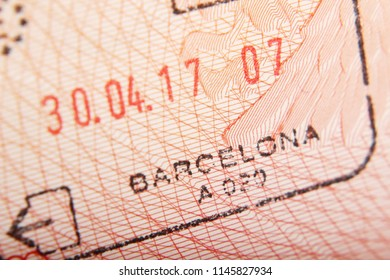 Departure stamp in a passport from Barcelona airport
