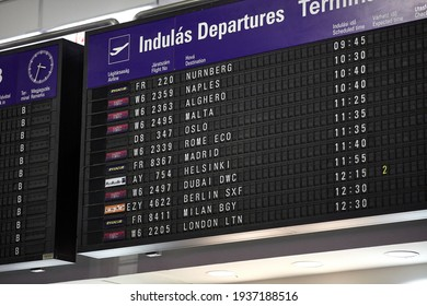 Departures board at the airport. Flight information mechanical timetable. Split flap mechanical departures board. Flight schedule.
