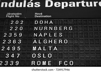 Departures board at the airport. Flight information mechanical timetable. Split flap mechanical departures board. Flight schedule. Budapest, Hungary. 16.09.2017