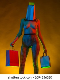 Dependence on purchases. Successful shopping. Shopping as a hobby. Sale in stores. Fashion and bags for shops. Erotic shopaholic. Last discounts, sales. Fashion show concept, naked body