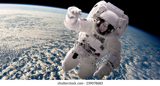 A depiction of an astronaut floating in outer space. A cloud covered Earth is below. Elements of this Image Furnished by NASA.