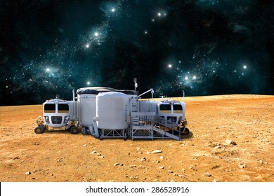 A depiction of a base on a hostile and barren planet. The small colony is equipped with two rovers for astronauts to use for exploration of the surface. -  Elements of this image furnished by NASA