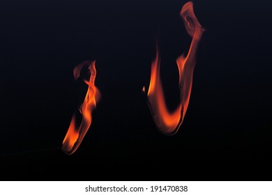 The depiction of fire burning around a metal wire