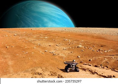 A depiction of a rover exploring an airless moon. An water covered world rises over the horizon. Elements of this image furnished by NASA.