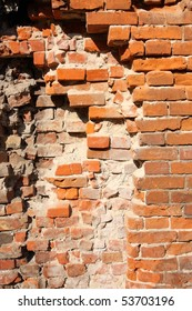 It depicts an old brick wall crumbling