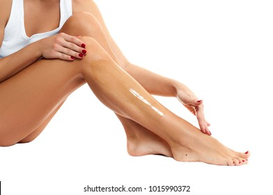 Depilation and Hair Removal. Waxing. Woman putting depilatory wax on her leg