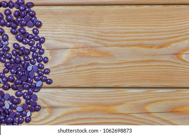 depilatory pearly solid wax beans on a wooden background